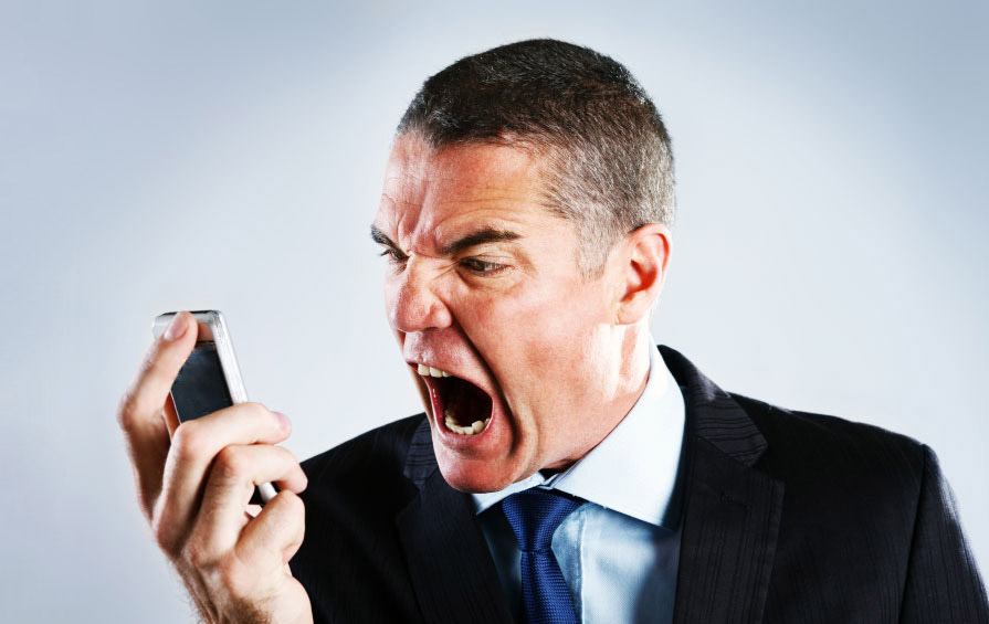 A man yelling at the phone